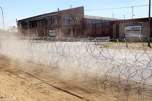 Deployed concertina razor wire barriers