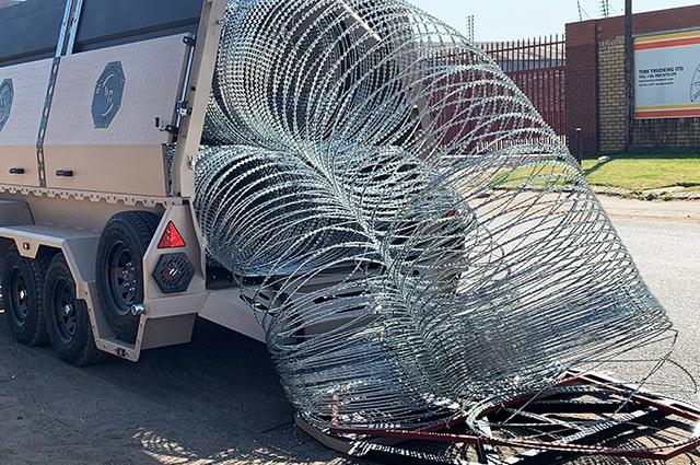 Military razor wire trailer deployment razor wire barriers