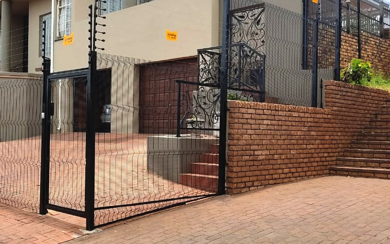 Pedestrian gate with clear view fence panel filling