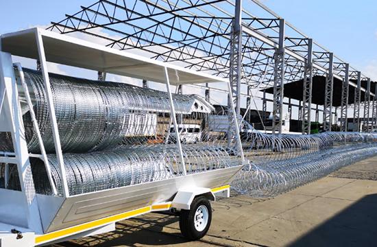 Razor wire trailer economo version rapid deployment barriers demonstration