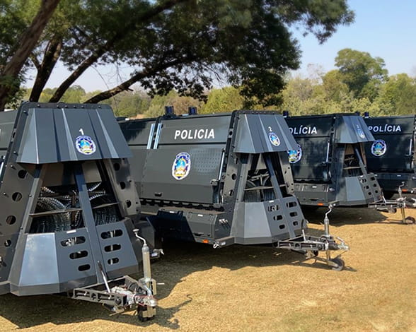 Razor wire police trailers for rapid deployment of concertina razor wire barriers