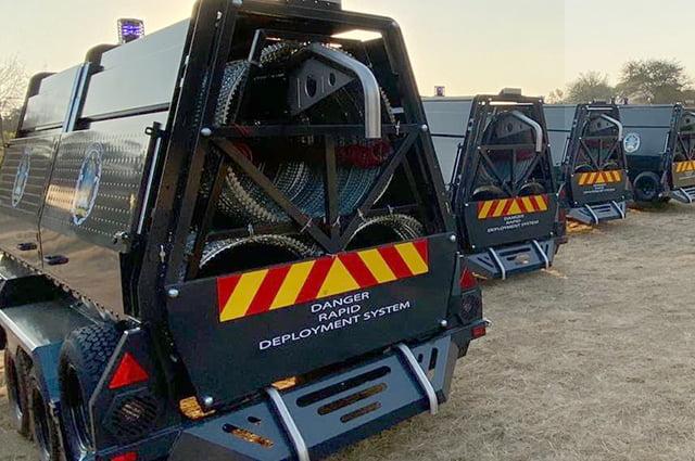 Police razor wire trailers