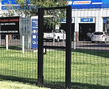 Clear view fencing around Engen garage with pedestrian gate