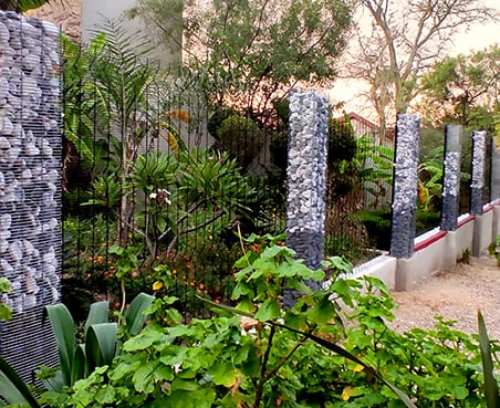 Clear view fencing with gabion pillars