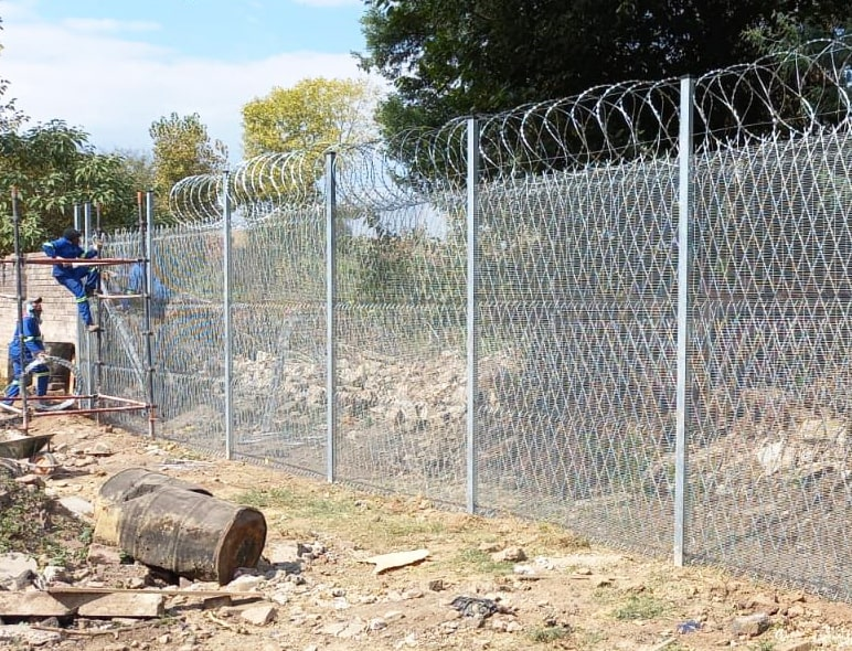 The recent installation of high-security fencing reinforced with razor wire mesh