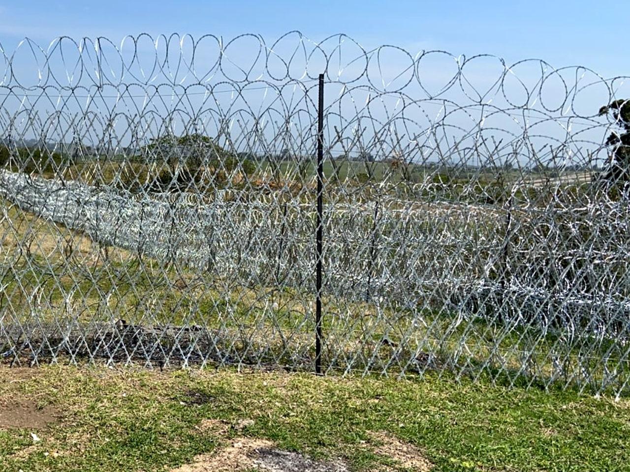 Concertina razor wire coils as wall