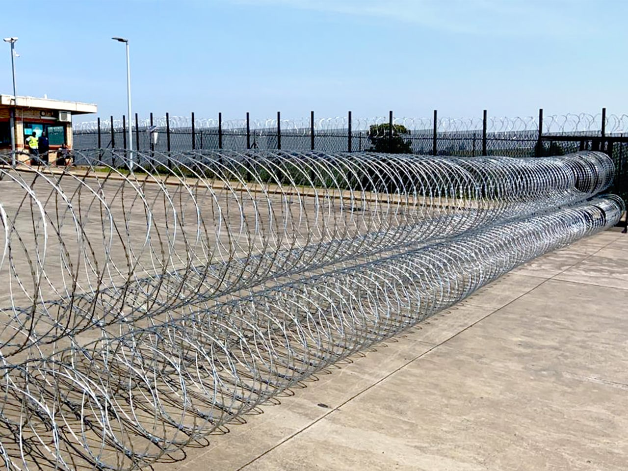 Gate protection rapid deployment concertina razor wire barriers deployed