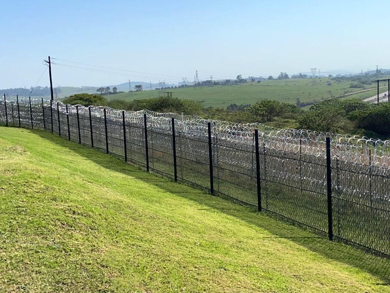 Two layers of perimeter protection razor wire mesh and concertina razor wire wall